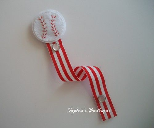 This cute red and white baseball Pacifier/Binky Clip is super stylish and makes an adorable paci holder