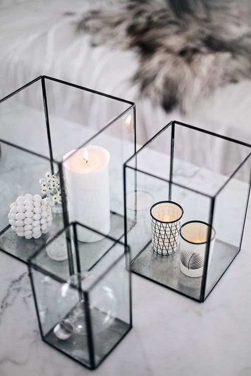 Candles in glass boxes - perfect combination of cozy and contemporary. I see using flameless/electric candles for this.: