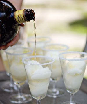 Tequila poured over lime sorbet with a salted glass rim for instant margaritas. Also use champagne for a dessert.