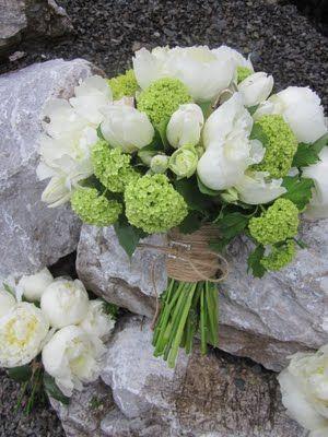 Viburnum and white tulips. White bouquet.