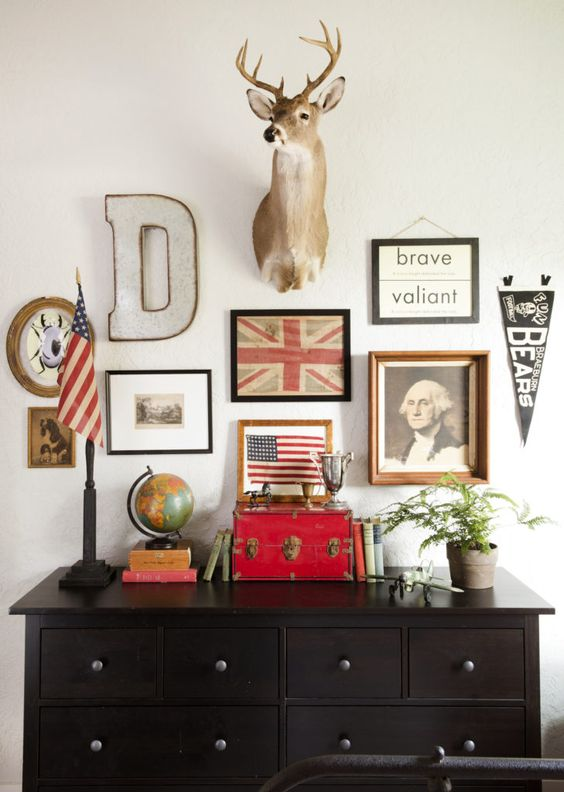 A patriotic farmhouse style gallery wall above a black dresser in a cottage decorated by Holly Mathis. #patriotic #decorating #cottage #modernfarmhouse #collage
