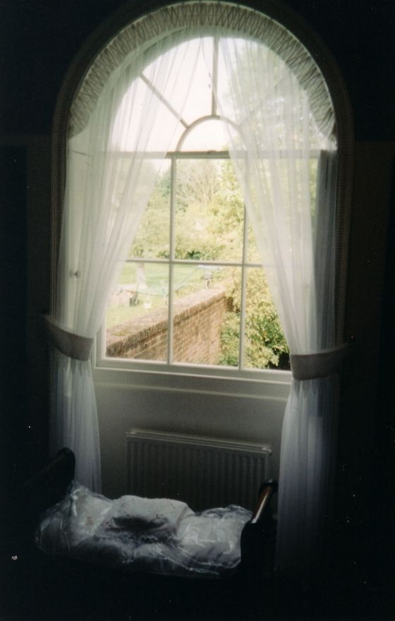Arched Window Dressed With Voile Curtain Inside Recess View