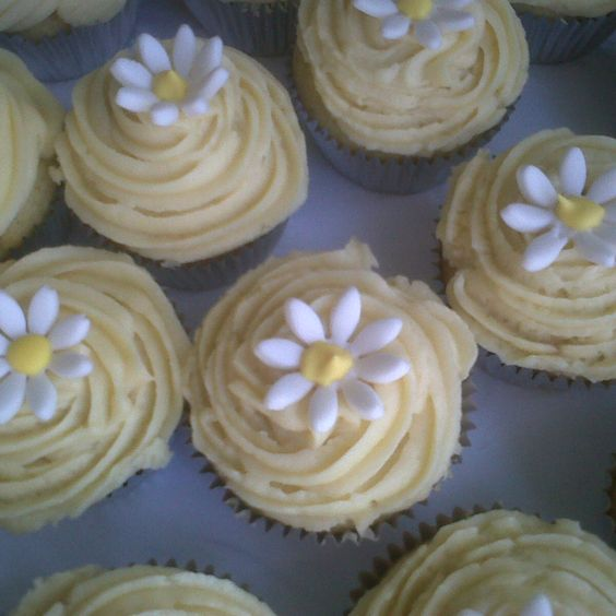 Red velvet cupcakes with cream cheese icing and edible daisies- Bouffe bakery