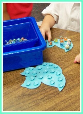 Plastic bath math with suction cups and marbles! Fine motor fun!