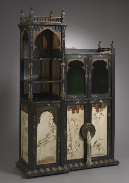 Cabinet, c. 1895 designed by Carlo Bugatti (Italian, 1856-1940) wood with metal inlays and painted parchment, glass doors and mirror.