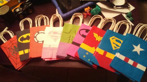 Superheros party bags - just finished making these for my nephews birthday party...he loves superheros and i saw a similar pin so i had to try it! It is pretty time consuming but only the individual logos. But what can i say my nephew is worth it! ^_^ #happyaunt #superheros #birthdayboy