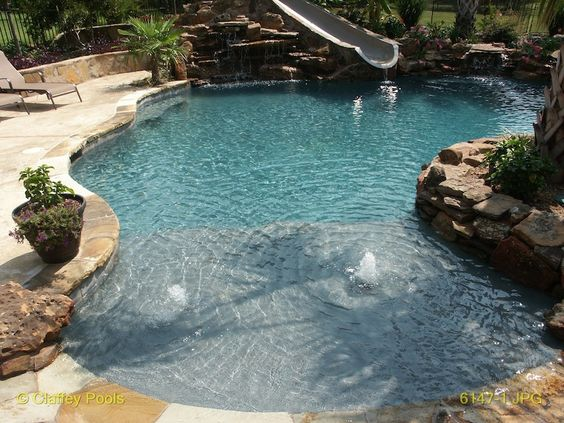 Affordable beach entry pools pool design for a tropical for Pool design with beach entry
