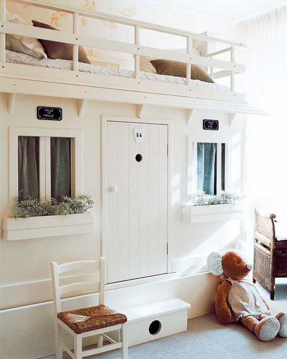 The sweetest idea for a child's bedroom - top bunk with play house below: