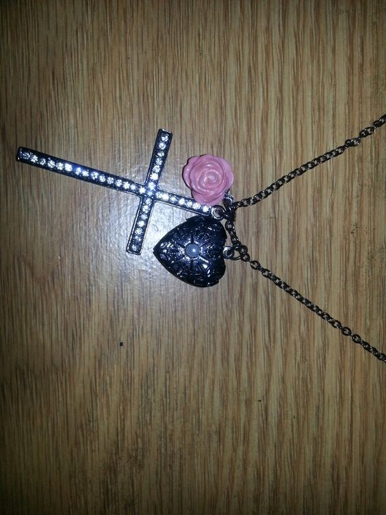 Got this for Xmas.  Super cute. I luv cross things.