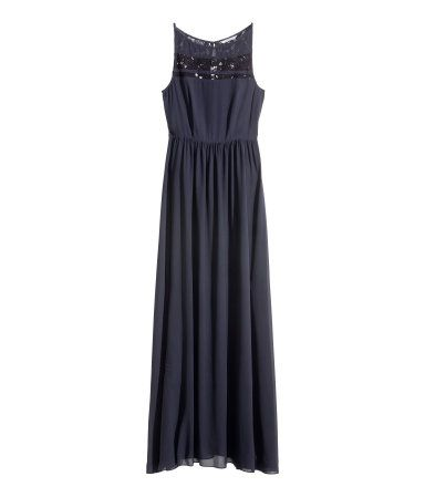 Sleeveless maxi dress in chiffon with lace insets at front and a lace back section. Boat neck with lace trim at neckline. Opening at back with covered button at back of neck. Seam at waist, flared skirt, and concealed back zip. Lined.