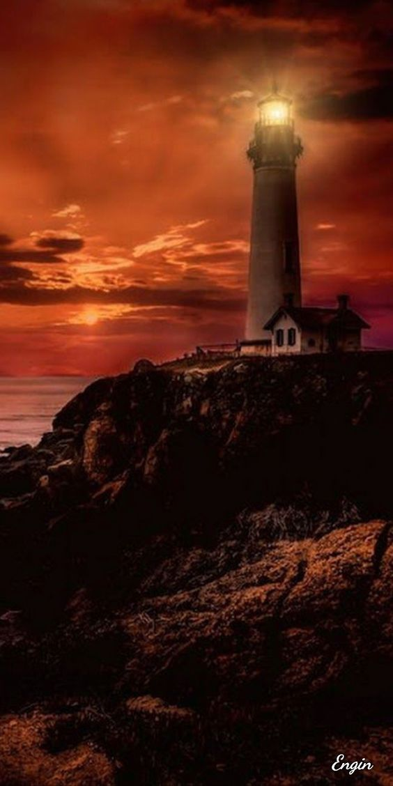 Lighthouse in red sky
