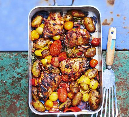 Amatriciana chicken traybake. Inspired by the classic Italian pasta sauce, chicken thighs and new potatoes are flavoured with bacon and tomato in this easy one-pan meal