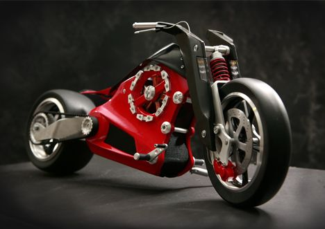 What's got two bald tires, runs on electricity, and is red and black all over? ZEVS! An elegant futuristic electric motorbike by three fellows.