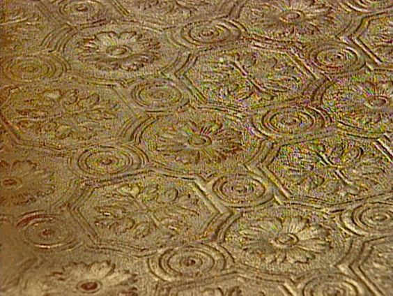 gold leaf finish to embossed wallpaper