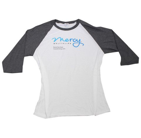 Logo Baseball T Easy-fit, soft baseball T with Mercy Multiplied logo and quarter length, colorblocked sleeves. Unisex sizing; Poly/cotton/rayon blend. Available in S-XL.