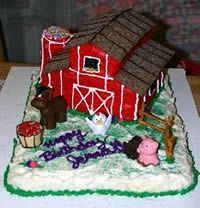 3rd cake).   Next... slice of the long edges of the top layer like the picture and frost the cake barn red except for the roof, frost it brown.  Top the roof with almond slivers or graham crackers.  To make the silo, secure layers of sandwich cookies on top of each other with a small amount of frosting.  Frost with the barn red and then top with a chocolate marshmallow pinwheel cookie.  Use a writing tip or tube frosting to crea