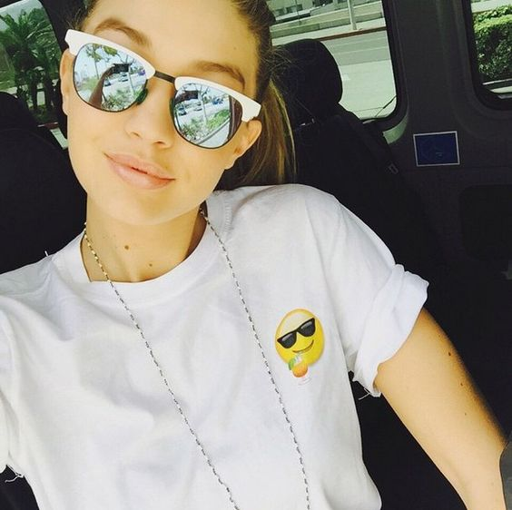 Pin for Later: Live Vicariously Through the Most Stylish Coachella Instagrams Gigi Hadid Had a Casual Ride to Coachella in Mirrored Sunglasses
