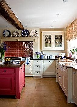 Love the red..the stove...the cabinets...