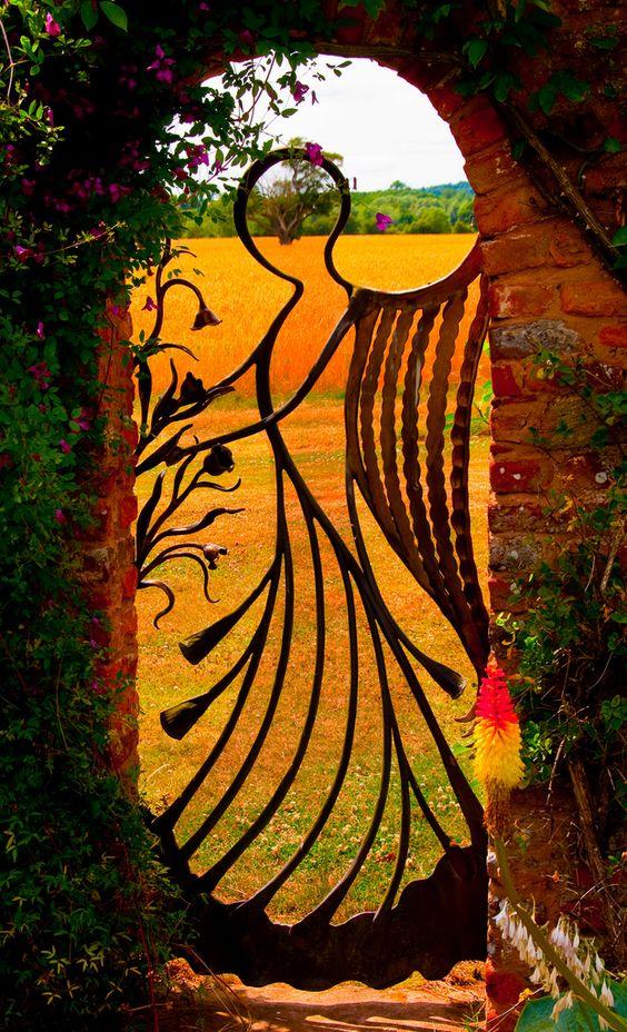 A unique garden gate in a garden wall