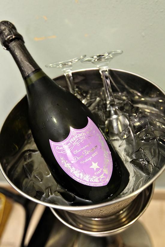 Vintage 2002 bottle of Dom Perignon Rosé champagne to match a purple wedding | Photography by Kenny Kim