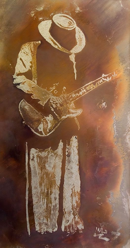 Stevie Ray Vaughn burned into stainless steel.