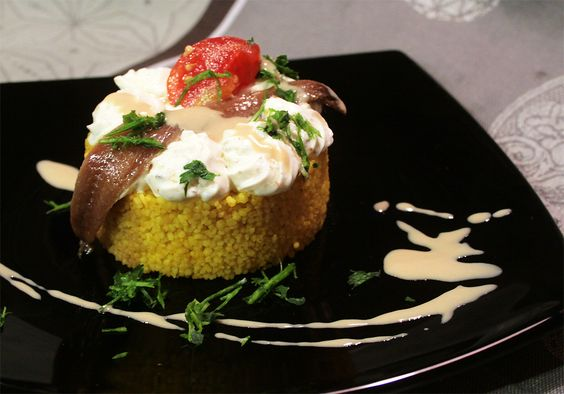 TORTINO MEDITERRANEO Couscous Tart with Tahini Yogurth, anchovys and  Hot Figue Heart
