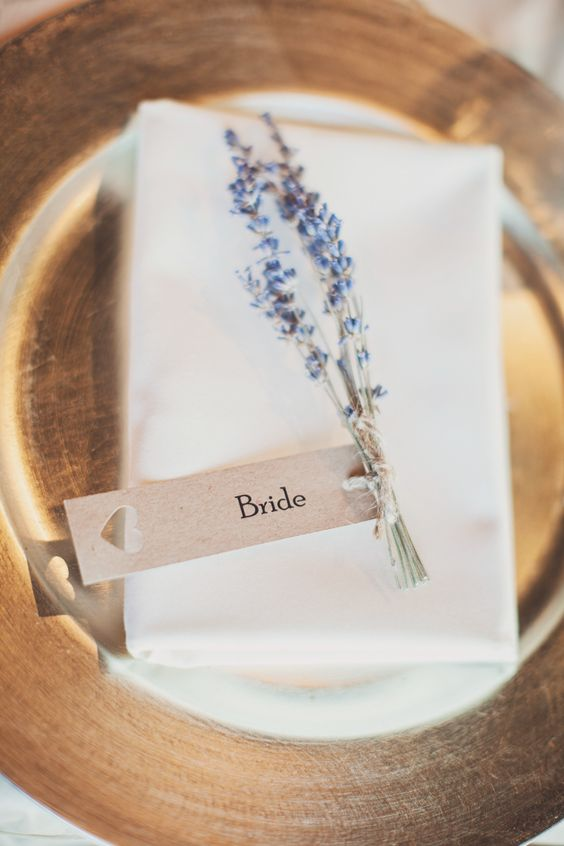 Gold plates, lavender sprigs & kraft paper name tag place setting - Image by Katy Melling Photography - Jenny Packham 'Willow' gown for a beach wedding at Newton Hall in Northumberland with a pink rose bouquet by Katy Melling Photography.