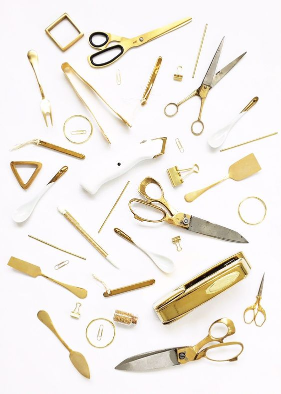 I like the photo layout of gold items ranging from scissors, clip binders, paper clips, forks and stirrers.: