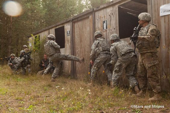 Though U.S. Army Europe's 2015 European Best Warrior Competition was an individual competition, certain segments, such as this room-clearing exercise, were judged on the individual soldiers' ability to work as a team. Here one team begins the process of clearing a room at Camp Aachen in Grafenwoehr, Germany, Wednesday, Sept. 16, 2015. (Michael Darnell/Stars and Stripes)