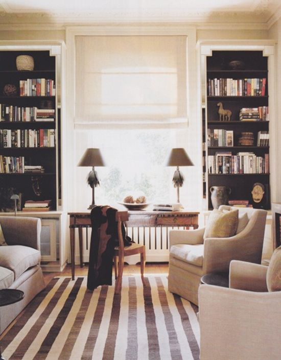 The bookcases look fab in this room framing the tall windows. The stripy rug draws in the eye too and the colours are really understated ..... So lovely: