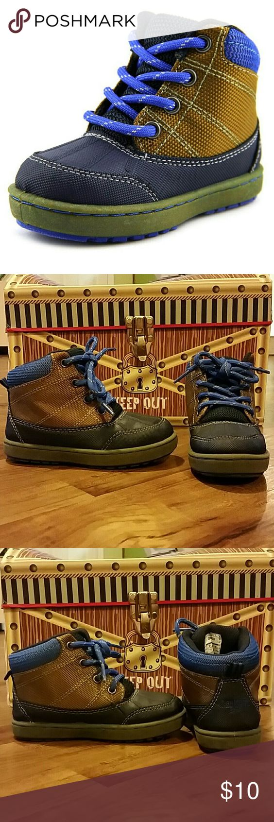 Osh Kosh Boots + Bonus! The Osh Kosh Liam 2 Boots feature a Canvas upper with a Round Toe . The Man-Made outsole lends lasting traction and wear. Navy and brown. Excellent condition - only worn once or twice! Throwing in a FREE pair of Gymboree slip ons (pic 4). In good used condition. Size 10 but fit like a 9. Osh Kosh Shoes Boots