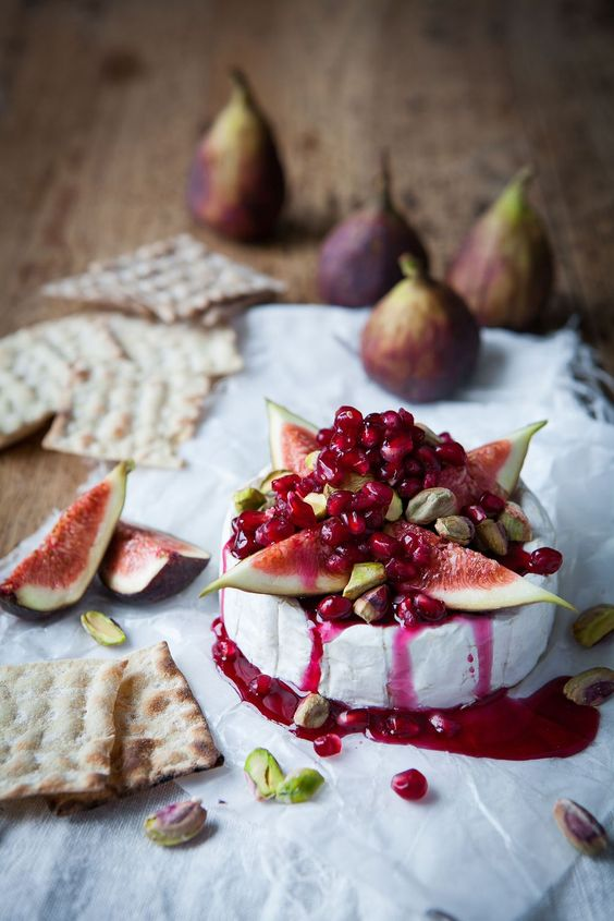 Warm camembert tart with pomegranate syrup fig & pistachio.: