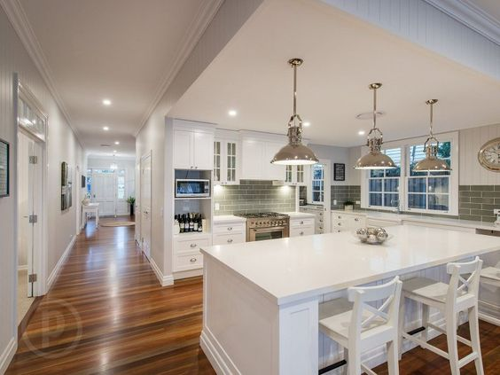 Love the white cabinets and hardwood floors. The gray/silver and white color scheme is gorgeous. Maybe add accent colors here and there?