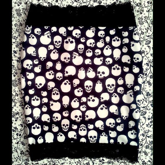 Skull mini skirt. Small medium Stretch skirt in size small/medium. New. Black stretch lace around too and bottom. Pet-free, smoke-free home. Skirts Mini