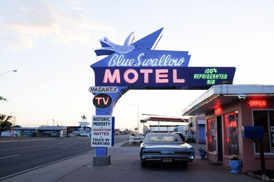 Make a stop for the night at the darling Blue Swallow Motel with an amazing vintage neon sign in Tucumcari, NM along Route 66. // saltycanary.com