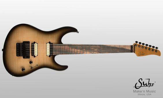 Suhr Custom Modern 7  Instrument Specifications: Serial Number: JS4Y4Q Body Wood: Flame Maple/Swamp Ash Neck Wood: Macassar Ebony/Roasted Maple Finish: Black Burst