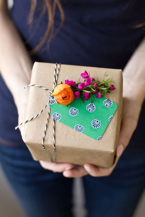 brown kraft paper..striped twine..florals..colorful tag: