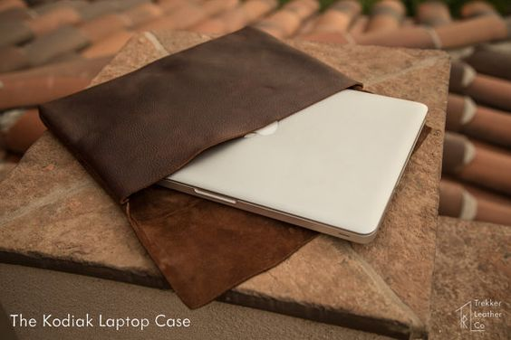 This leather laptop case is made from Brazilian kodiak bear, and stitched with a white nylon thread.