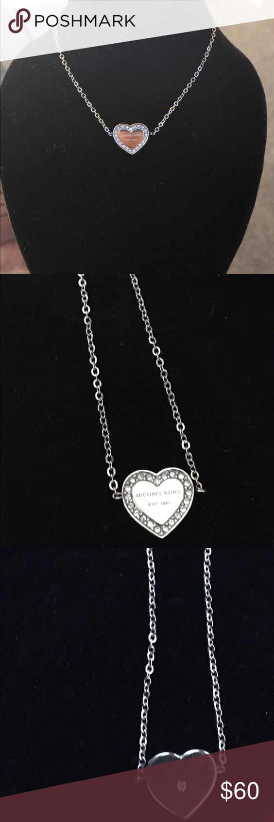"""Michael Kors Pave Silver-Tone Heart Charm Bracelet NWOT. In perfect condition and ready for the gift giving season! This is the perfect simple elegant piece of jewelry for the special someone in your life.  The heart charm is accented by beautiful sparkly stones and a single centered on the back. Make it yours today! ***measures up to size 7"""" Michael Kors Jewelry Bracelets"""