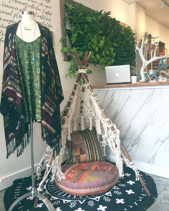 Macrame teepee and comfy cushions