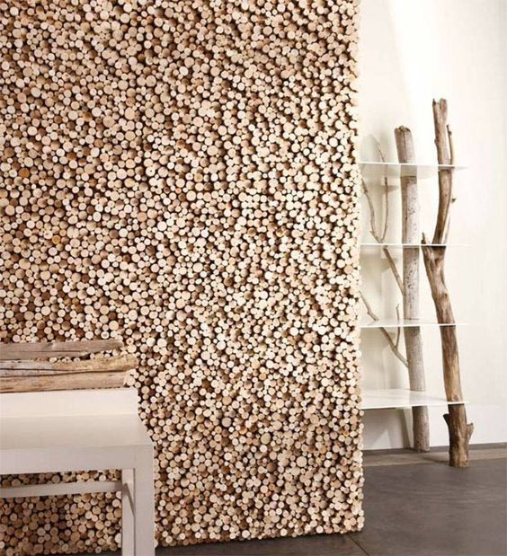 seen on archiproducts this unique wall covering made of rough cut wood pieces in differing