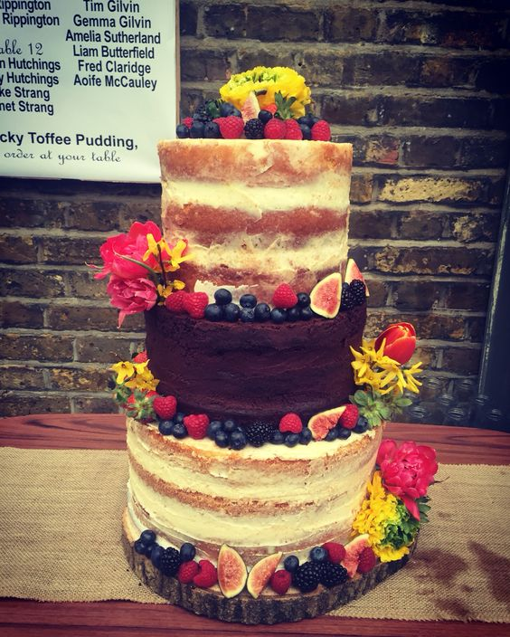 Naked Wedding Cake with spring flowers & berries