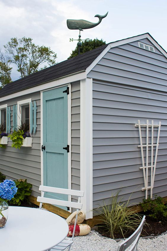 this coastal she shed is an adorable backyard retreat. Black Bedroom Furniture Sets. Home Design Ideas