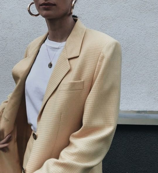 Oversized pastel yellow blazer with gold hoops