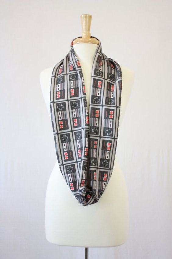 NES controller infinity scarf (organic cotton) on Etsy, $30.00 can you say awesome!! Yes I did just order this lol
