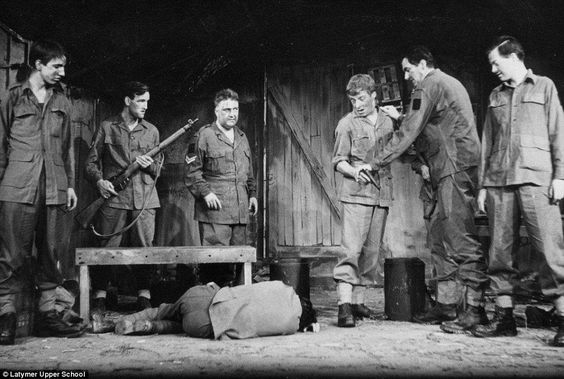 Drama: Rickman, left, in The Long and the Short and the Tall, which is set in the Second World War, during his time at the West London school which he attended on a scholarship: