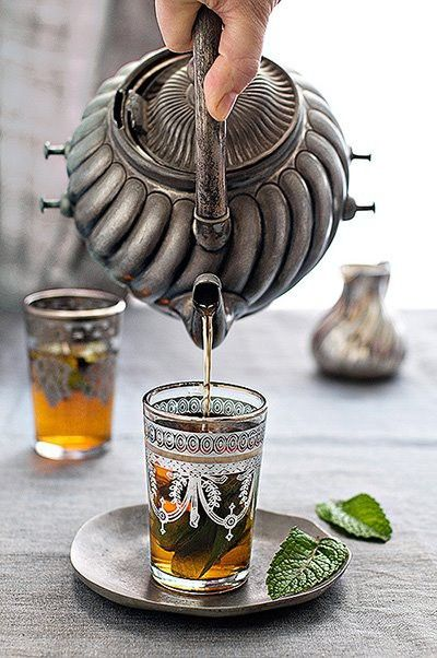 love the silver tea pot and the metallic rimmed glasses...