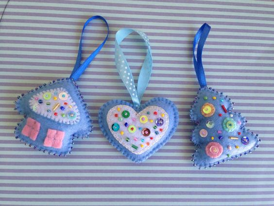 Set of 3 beautiful Christmas ornaments - a house, a heart and a Christmas tree. Hand embroidered and hand stitched. Measures approximately 2.5 x 2.5 .