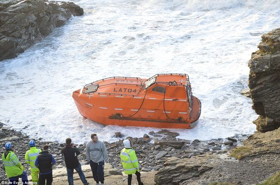 Stranded: This lifeboat from a large tanker became detached and washed up on a Pembrokeshire beach today in strong winds