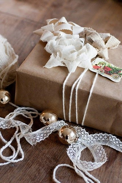 Pinked strips of fabric make pretty bows on brown paper wrapped package.